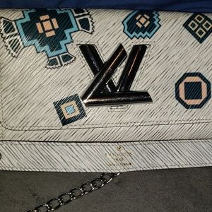 Louis Vuitton Bag. Leather Aztec epi twist wallet